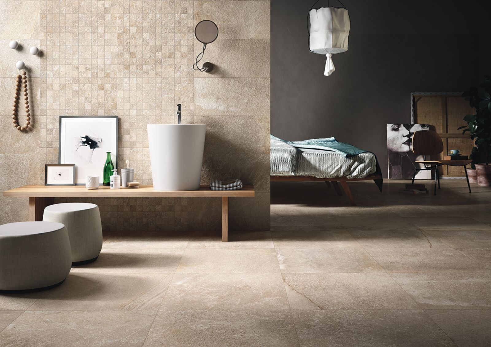 A new material inspired by the sedimentary dolomitic rock from the Limestone family, found in the Appalachian Mountains in North America. A stone with a rugged appeal that combines quartzite and porphyry and recalls the same subtle shades that  appear in nature, from grey to brown to black.  - AM BRIXSTONE 1 - Imola Ceramica