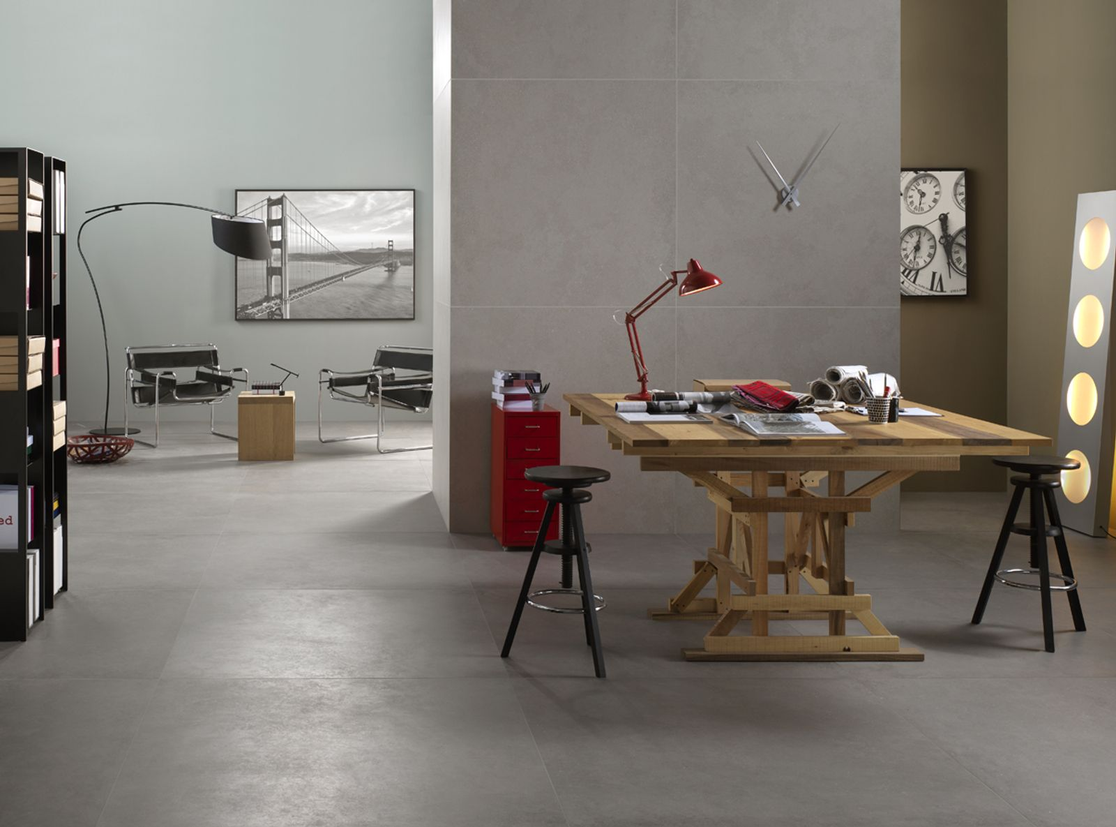 The concrete is turned into a tile with a clear contemporary mood, designed to inspire and surround exterior surfaces, but also ventilated facades and high-traffic public spaces. Its minimalist style features in flooring that is highly modular in different sizes depending on requirements and the desired visual effect. - AM CONCRETE 2 - Imola Ceramica