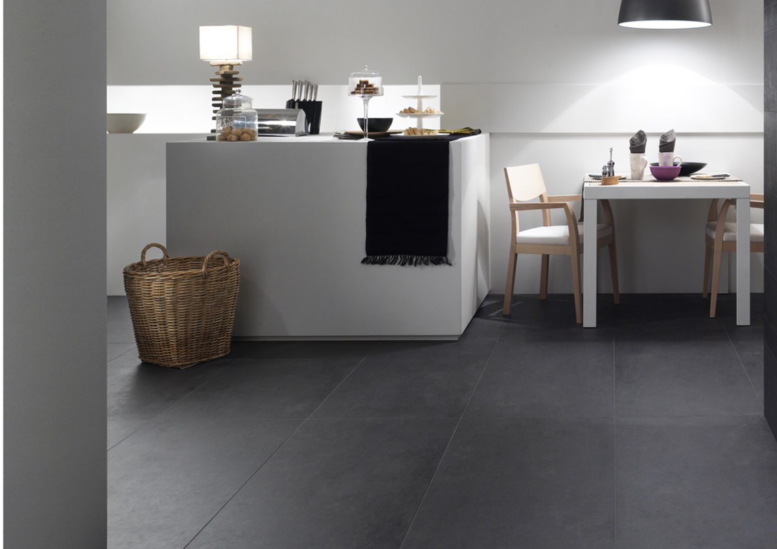 The concrete is turned into a tile with a clear contemporary mood, designed to inspire and surround exterior surfaces, but also ventilated facades and high-traffic public spaces. Its minimalist style features in flooring that is highly modular in different sizes depending on requirements and the desired visual effect. - AM CONCRETE 6 - Imola Ceramica